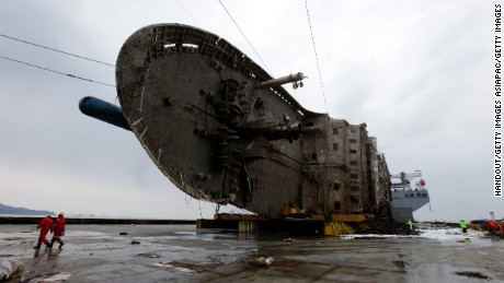 JINDO-GUN, SOUTH KOREA - MARCH 26: In this handout photo released by the South Korean Ministry of Oceans and Fisheries, The sunken Sewol ferry on a semi-submersible transport vessel during the salvage operation in waters off Jindo, on March 26, 2017 in Jindo-gun, South Korea. The Sewol sank off the Jindo Island in April 2014 leaving more than 300 people dead and nine of them still remain missing. Workers are in the process of an attempt to raise the ferry from the water in the hope that the disasters' final victims will be found. (Photo by South Korean Ministry of Oceans and Fisheries via Getty Images)