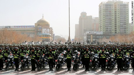 Chinese police make a show of force at a rally in Hetian, Xinjiang, on February 27.