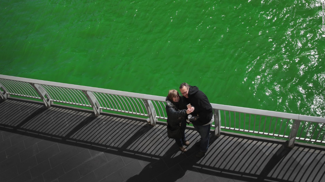 People take a selfie along the Chicago River shortly after it was dyed green on Saturday, March 11. The green dye has been a St. Patrick's Day tradition in Chicago since 1962.