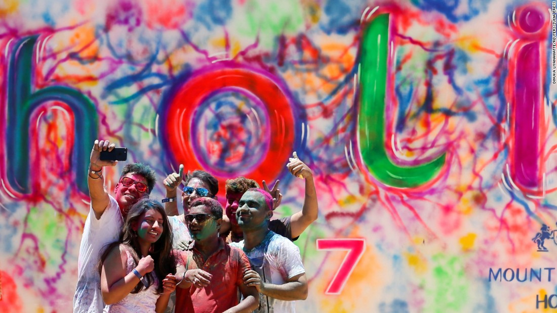 "Young people in Colombo, Sri Lanka, take selfies during the <a href=""http://www.cnn.com/2017/03/13/asia/gallery/holi-2017/index.html"" target=""_blank"">Holi festival of colors</a> on Sunday, March 12."