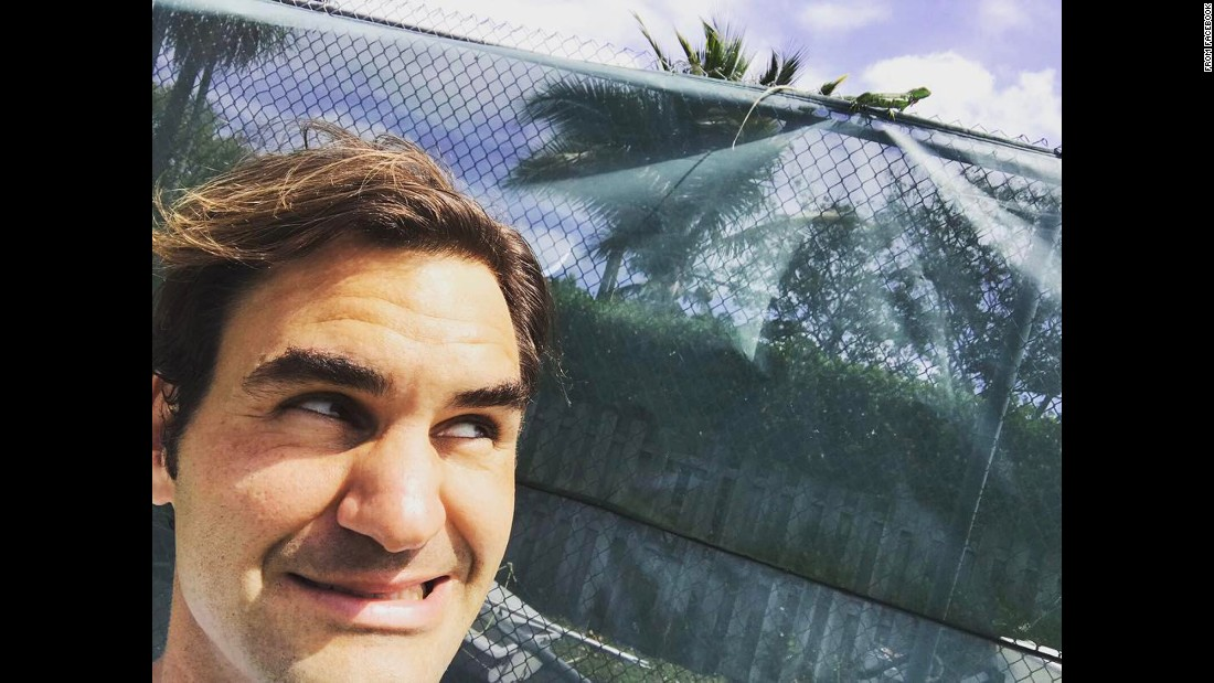 "Tennis star Roger Federer <a href=""https://www.facebook.com/Federer/posts/10155126293434941:0"" target=""_blank"">takes a selfie</a> with an iguana he encountered at the Miami Open on Saturday, March 25."