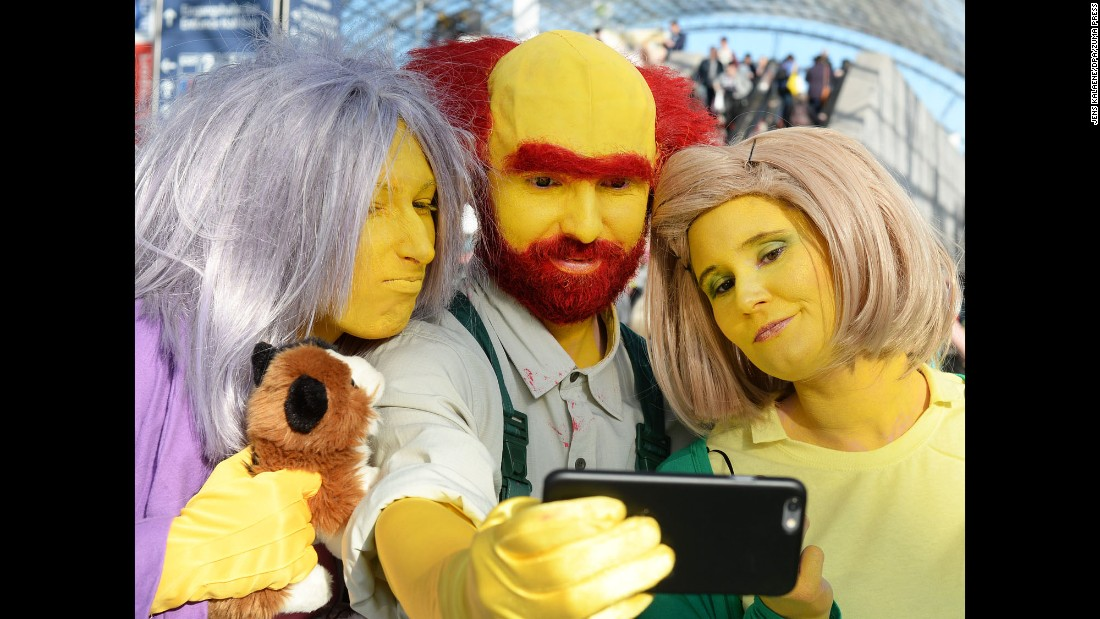 "People dressed up as characters from ""The Simpsons"" pose for a selfie Thursday, March 23, at the Leipzig Book Fair in Leipzig, Germany."
