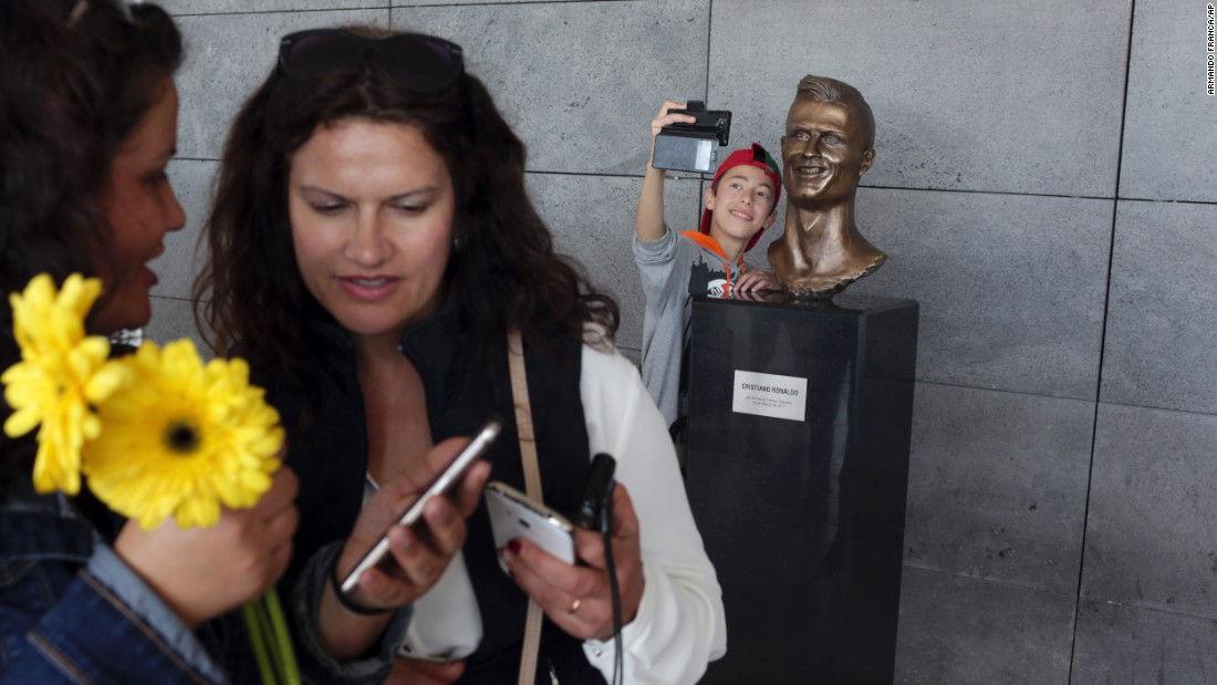 "A boy takes a selfie next to a bust of soccer star Cristiano Ronaldo at the international airport outside Funchal, Portugal, on Wednesday, March 29. The airport was just renamed in Ronaldo's honor. The bust <a href=""http://www.cnn.com/2017/03/29/football/cristiano-ronaldo-airport-madeira-bust-statue-unveiling/"" target=""_blank"">stole many of the headlines, </a>especially on social media."
