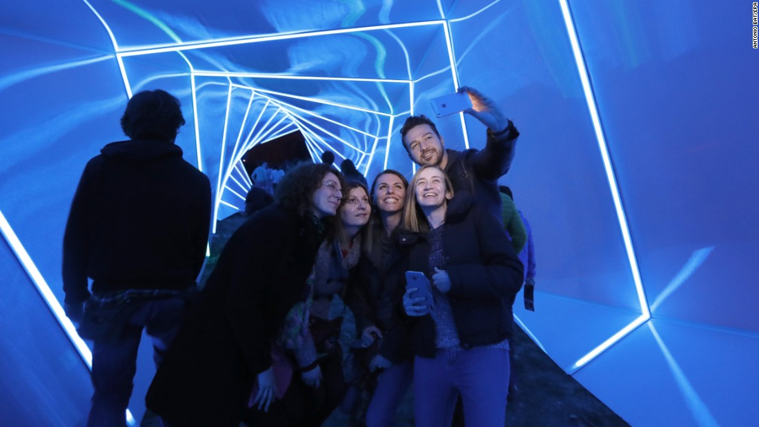 People visit a light installation during the Festival of Lights in Zagreb, Croatia, on Thursday, March 16.