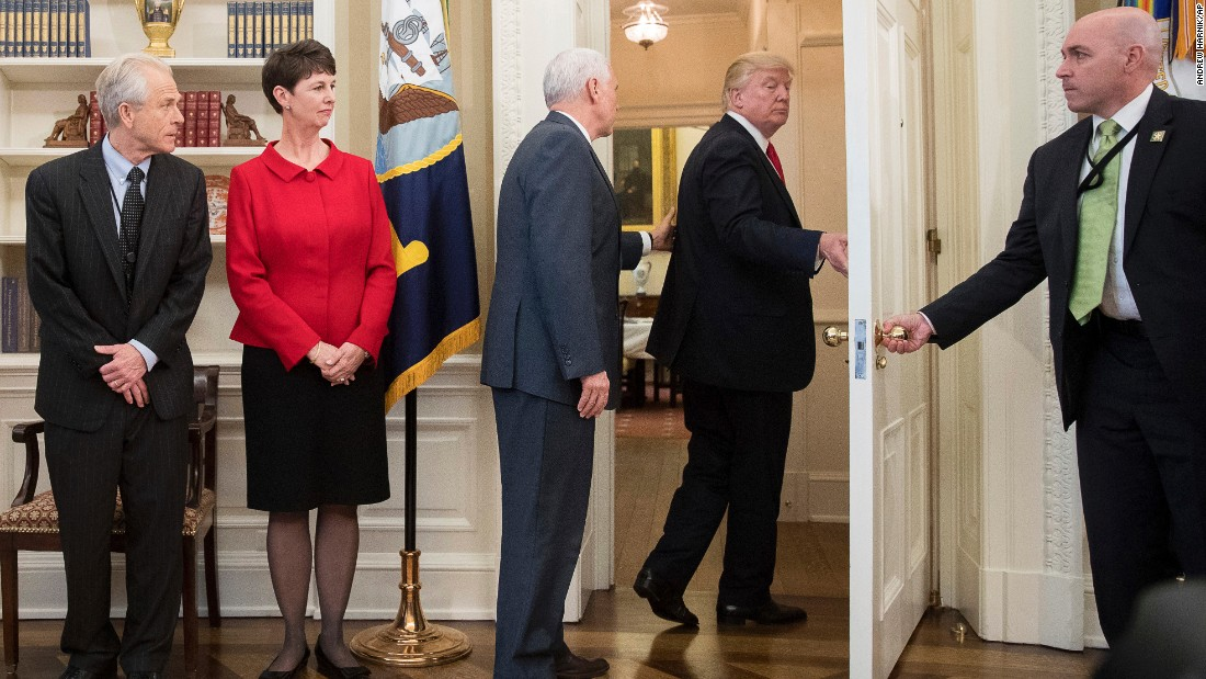 "Vice President Mike Pence, third from left, tries to stop President Donald Trump <a href=""http://www.cnn.com/2017/03/31/politics/donald-trump-executive-order-signing-walk-out/index.html"" target=""_blank"">as Trump walks out of an executive order signing ceremony</a> on Friday, March 31. During the signing ceremony, White House pool reporters asked Trump questions about former national security adviser Michael Flynn, who has offered to testify on Russian involvement in the US election. The President ignored the questions and moved to another room to sign the two executive orders, which regarded trade policy."