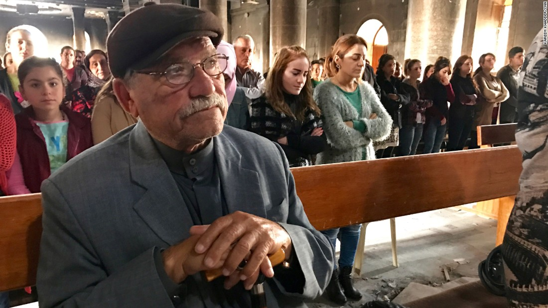 "Yacoub Hanna, 76, at a mass held at the church. He said he was shocked to see what ISIS did to his city. ""I felt pain,"" he said. ""My eyes filled with tears."""