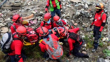 "Members of the ""Topos"" (moles) Mexican search and rescue group take part in a drill in Mexico City, on September 13, 2015. Next September 19 commemorates the 30th anniversary of the Mexico City's earthquake that left thousands dead. AFP PHOTO/RONALDO SCHEMIDT        (Photo credit should read RONALDO SCHEMIDT/AFP/Getty Images)"
