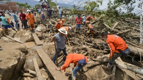 On April 2, rescuers search for victims trapped under debris left by mudslides in Mocoa, Colombia.