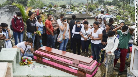 Relatives and friends of Deisy Rosero, 26, pray during her funeral at a cemetery in Mocoa, Putumayo department, southern Colombia on April 3, 2017. Residents of Mocoa were Monday desperately searching for loved ones missing since devastating mudslides slammed into the remote Colombian town, as the death toll soared to over 250, including 43 children. / AFP PHOTO / LUIS ROBAYO        (Photo credit should read LUIS ROBAYO/AFP/Getty Images)