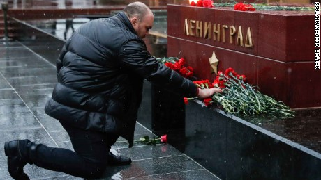 A man lays flowers in memory of the victims of the St. Petersburg metro explosion.