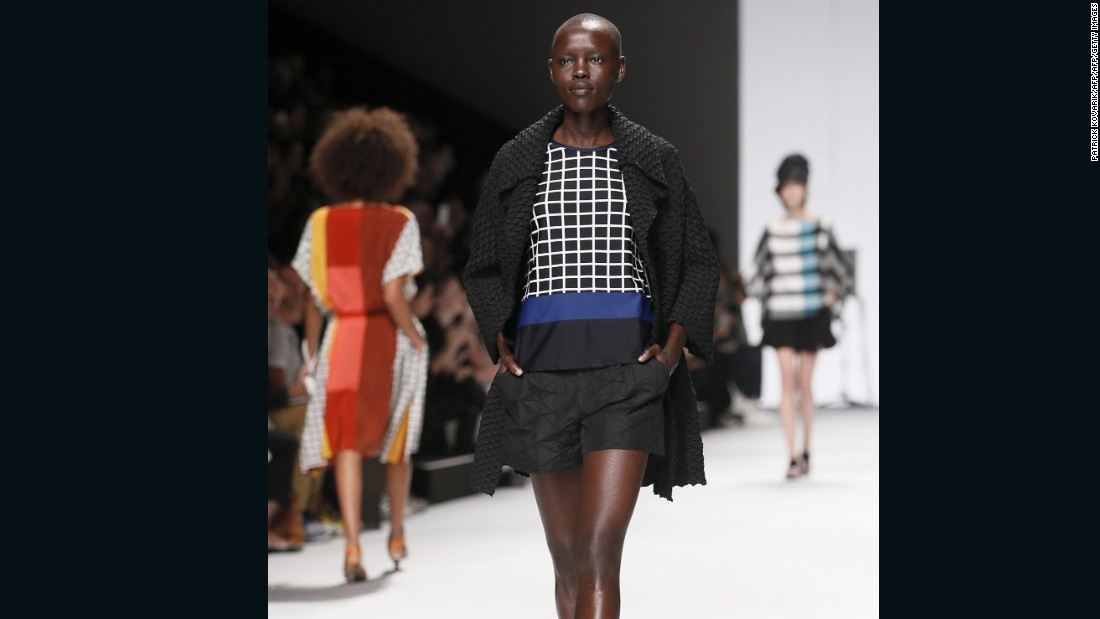 Pictured here, Grace Bol  presents a creation for Issey Miyake during the 2015 Spring/Summer ready-to-wear collection fashion show in Paris.   <br />Born in South Sudan, as a child Bol's family relocated to the US.  The 27-year-old has walked for Givenchy and Vivienne Westwood shows in Paris.
