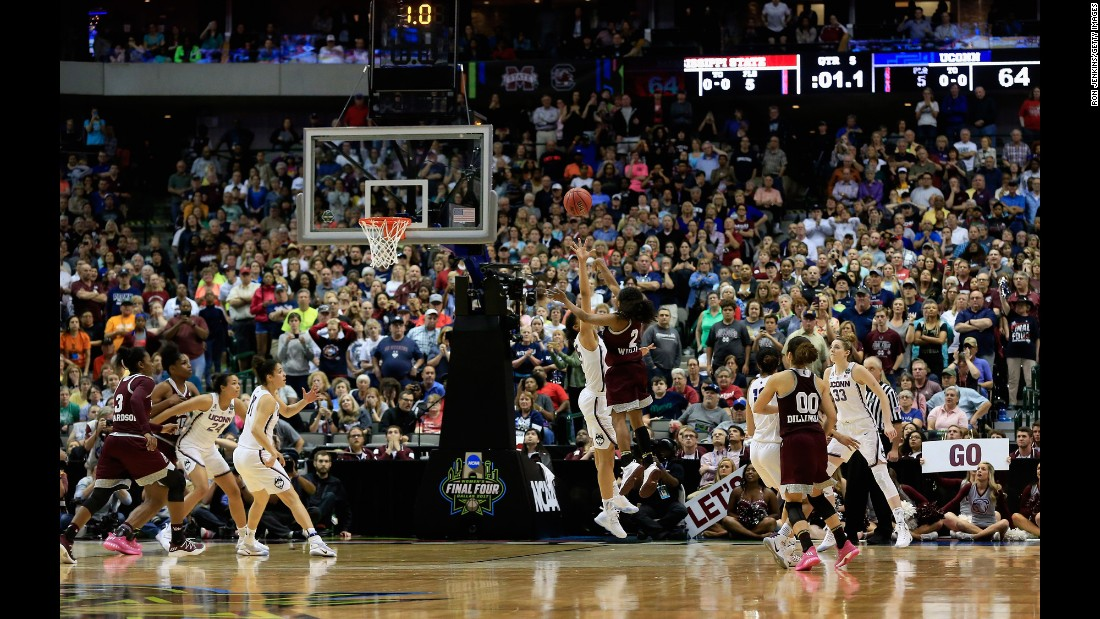 "Mississippi State point guard Morgan William <a href=""http://bleacherreport.com/articles/2700711-uconns-111-game-win-streak-ends-with-ot-buzzer-beater-loss-to-mississippi-state"" target=""_blank"">shoots the game-winning basket</a> against No. 1 Connecticut on Friday, March 31. The Final Four upset ended UConn's 111-game winning streak, an NCAA record."