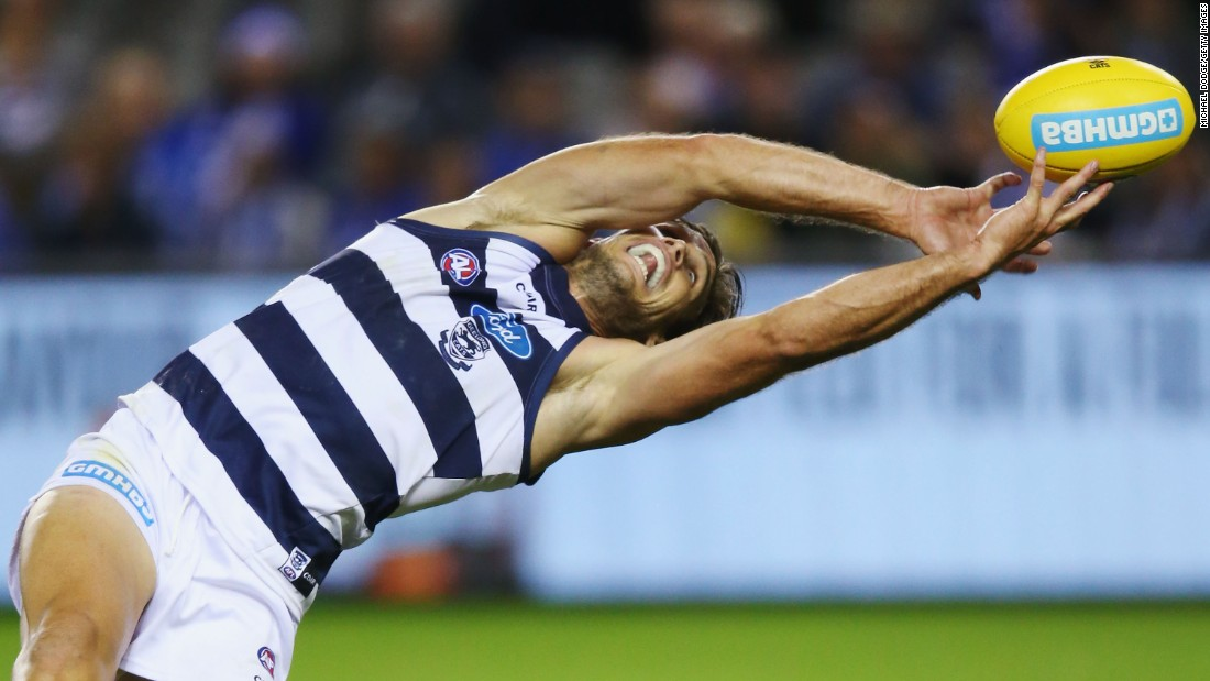 Geelong's Tom Hawkins reaches for the ball during an Australian Football League match in Melbourne on Sunday, April 2.
