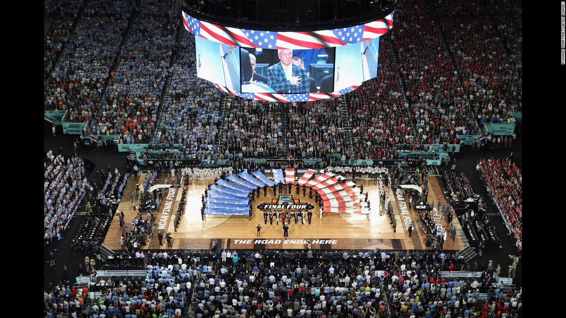 Williams is seen on the jumbotron during the national anthem.