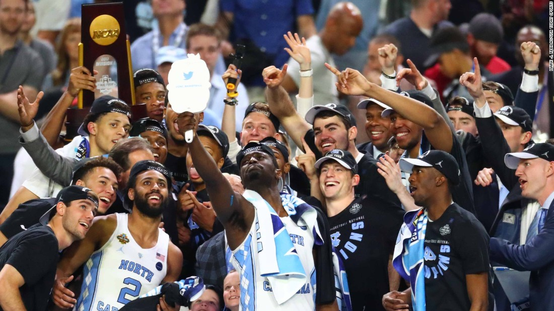 North Carolina players take a selfie together after being handed the trophy.