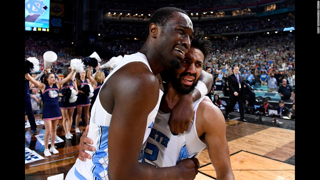 North Carolina's Theo Pinson, left, and Joel Berry II embrace after the NCAA Tournament final on Monday, April 3. North Carolina defeated Gonzaga 71-65 for its sixth national title and first since 2009.
