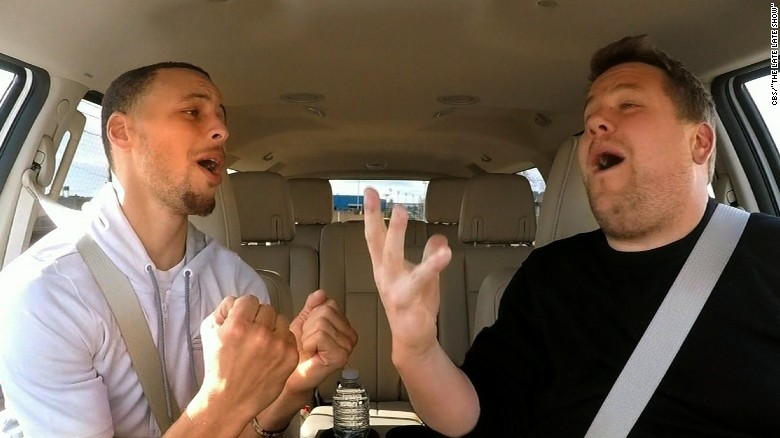 Warrior Stephen Curry battles off court with James Corden