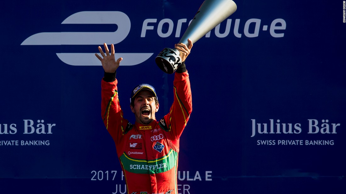 Lucas di Grassi celebrates at the Autodromo Hermanos Rodriguez after winning the Mexico City ePrix.