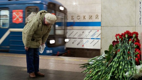 A woman pays her respects at a memorial at the Tekhnologichesky Institute metro station in St. Petersburg on Tuesday.