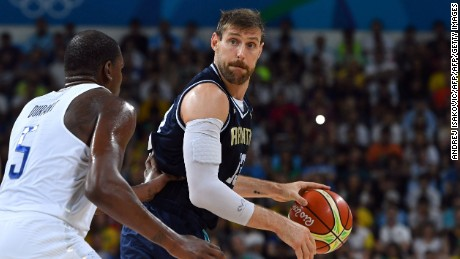 USA's guard Kevin Durant (L) holds off Argentina's small forward Andres Nocioni during a Men's quarterfinal basketball match between USA and Argentina at the Carioca Arena 1 in Rio de Janeiro on August 17, 2016 during the Rio 2016 Olympic Games. / AFP / Andrej ISAKOVIC        (Photo credit should read ANDREJ ISAKOVIC/AFP/Getty Images)