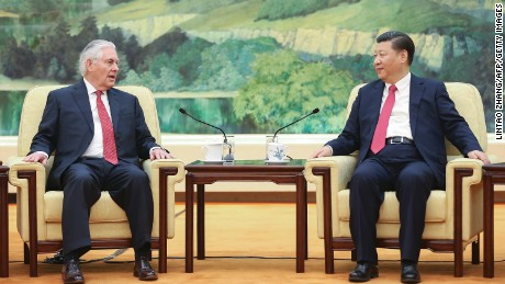 Xi (R) meets with US Secretary of State Rex Tillerson (L) in Beijing on March 19.