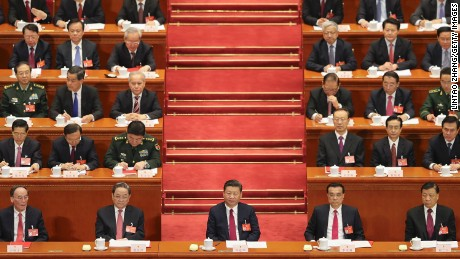 President Xi Jinping (center) attends the 12th National People's Congress (NPC) on March 15 in Beijing, China.