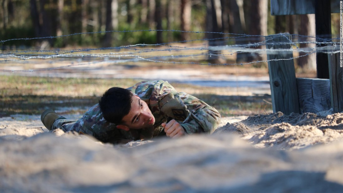 Spc. Mason Mackrell of the Georgia Army National Guard crawls under barbed wire during an obstacle course competition in Fort Stewart, Georgia, on Friday, March 10.