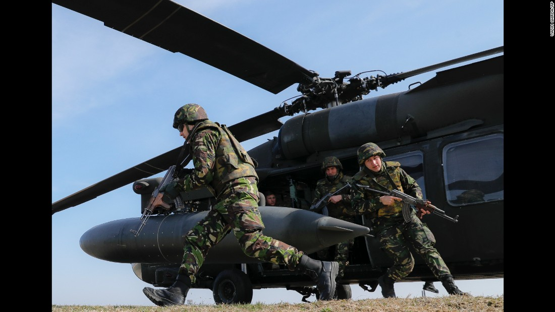 Romanian troops run out of an US Army helicopter during a joint exercise in eastern Romania on Wednesday, March 8.