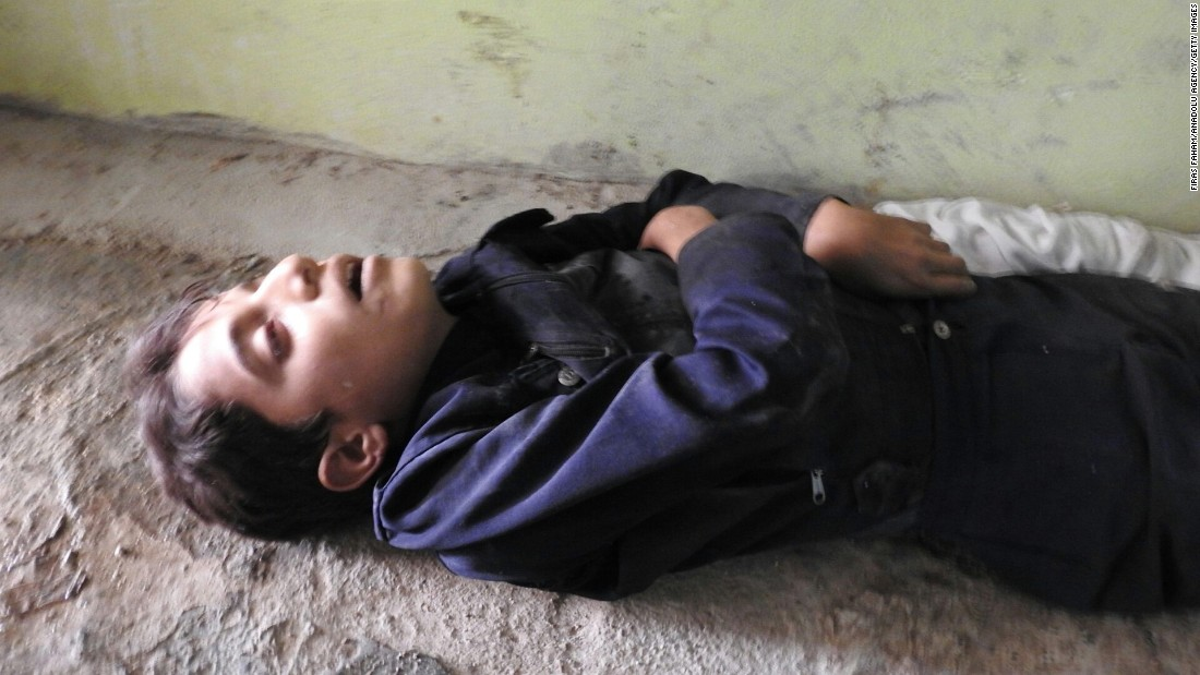 A child's body is seen in Khan Sheikhoun.