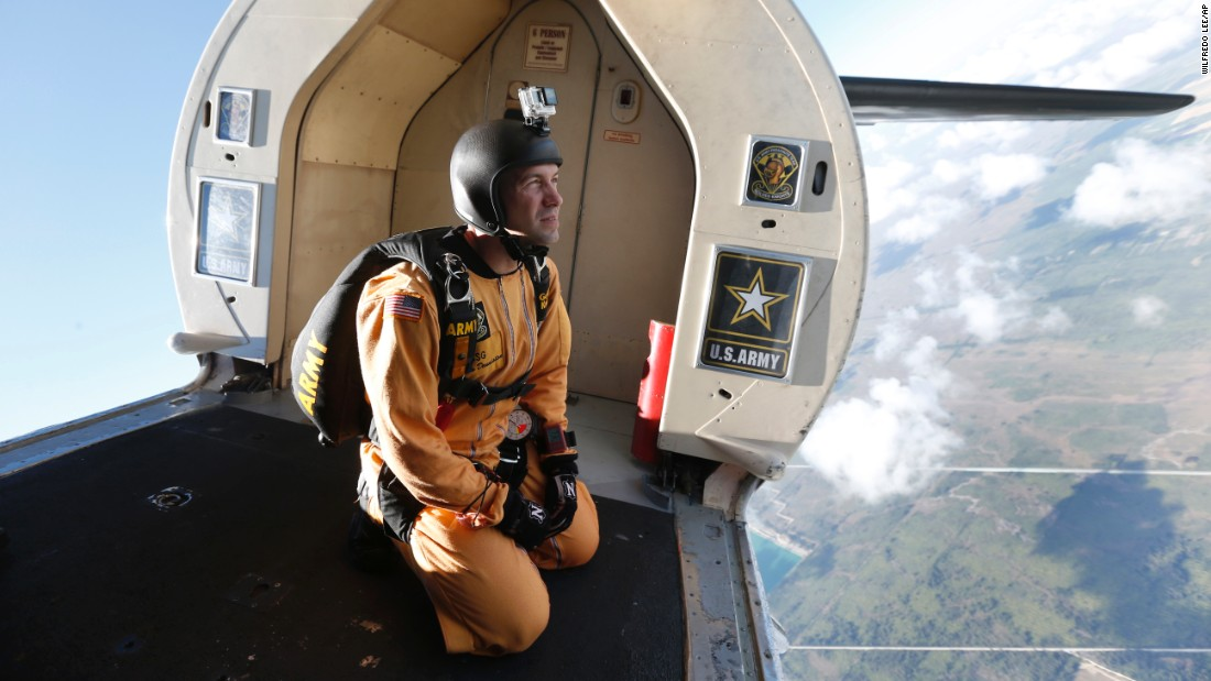 "Staff Sgt. Marcus Denniston, a member of the US Army's ""Golden Knights"" Parachute Team, prepares for a training jump Wednesday, March 8, in Homestead, Florida."