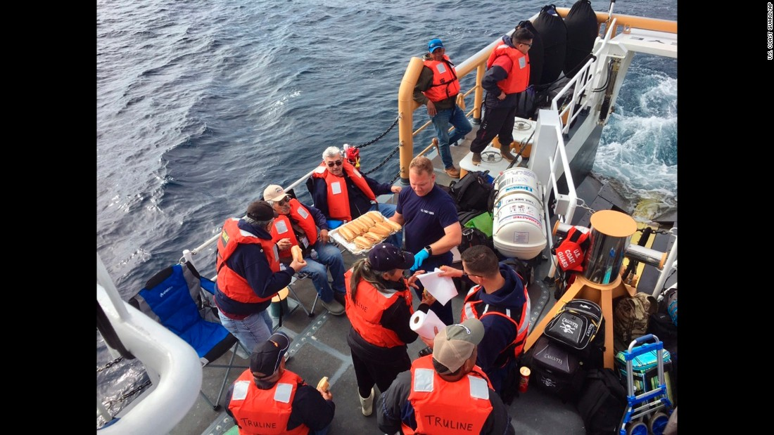 Passengers of the charter fishing vessel Truline are rescued by the US Coast Guard after their boat took on water south of San Clemente Island, California, on Sunday, March 19.
