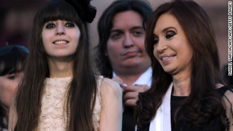 Argentina's reelected President Cristina Fernandez de Kirchner (R) smiles next to her daughte Florencia and her son Maximo, during her inauguration ceremony, in Mayo square, Buenos Aires on December 10, 2011. President Cristina Kirchner was sworn in Saturday to a second four-year term at the peak of her popularity but with the country's booming economy shadowed by Europe's financial crisis. AFP PHOTO /  DANIEL GARCIA (Photo credit should read DANIEL GARCIA/AFP/Getty Images)