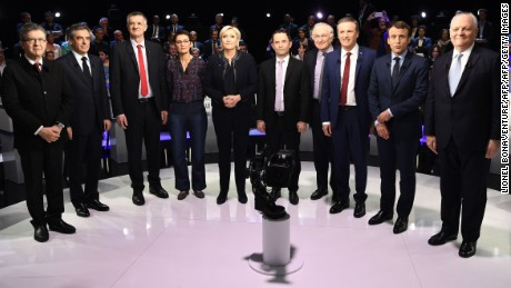 Ten of the 11 candidates in the French presidential election pose for a group photo at the debate.