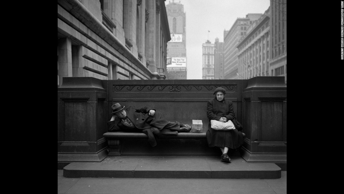 "A man and woman share a bench outside the New York Public Library in 1949. ""When you see (Feinstein's) pictures, you think: 'Wow, what a beautiful world. What a beautiful America,' "" Bigaignon said. ""It's like a long-gone America."""