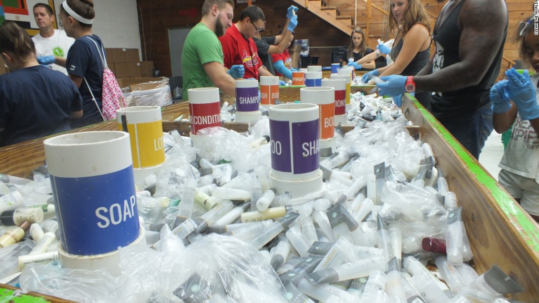 Volunteers sort toiletry products at Clean the World's Orlando recycling plant during an event celebrating Global Handwashing Day in 2016.