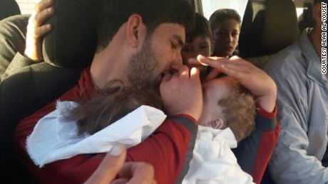Youssef holds his twins, who were killed in Tuesday's chemical attack.