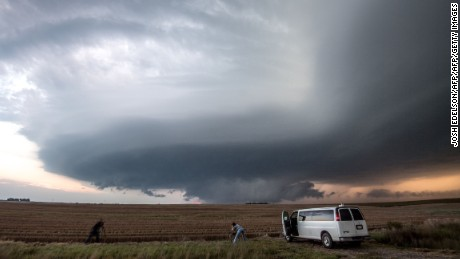 "Storm chasing photographers take photos underneath a rotating supercell storm system in Maxwell, Nebraska on September 3, 2016. Although multiple tornado warnings were issued throughout the area, no funnel cloud touched down. / AFP / Josh Edelson / XGTY RESTRICTED TO EDITORIAL USE  / MANDATORY CREDIT:  ""AFP PHOTO / Josh EDELSON"" / NO MARKETING / NO ADVERTISING CAMPAIGNS /  DISTRIBUTED AS A SERVICE TO CLIENTS  ==        (Photo credit should read JOSH EDELSON/AFP/Getty Images)"