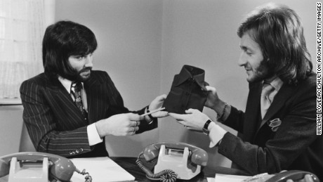 Northern Irish footballer George Best (1946 - 2005) with entrepreneur Harold Tillman (right), UK, 17th January 1971. Best has been recruited to help publicise Tillman's fashion enterprise.  (Photo by William Lovelace/Daily Express/Getty Images)
