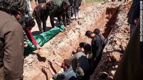 Syrians dig a grave to bury bodies in the Khan Sheikhun attack.