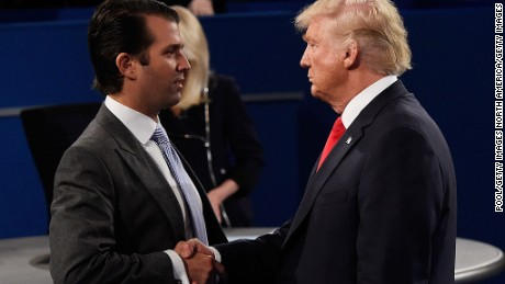 Donald Trump, Jr. (L) greets his father Republican presidential nominee Donald Trump during the town hall debate at Washington University on October 9, 2016 in St Louis, Missouri.