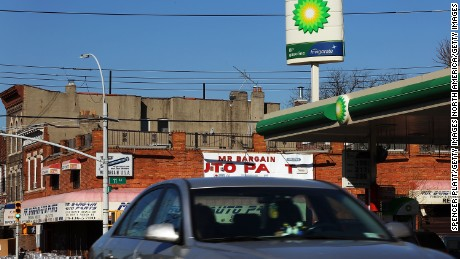 NEW YORK, NY - FEBRUARY 02:  Cars drive by a BP gas station in Brooklyn on February 2, 2016 in New York City.  The oil industry giant reported on Tuesday a $3.3 billion fourth-quarter loss as oil prices continue to fall globally.  (Photo by Spencer Platt/Getty Images)