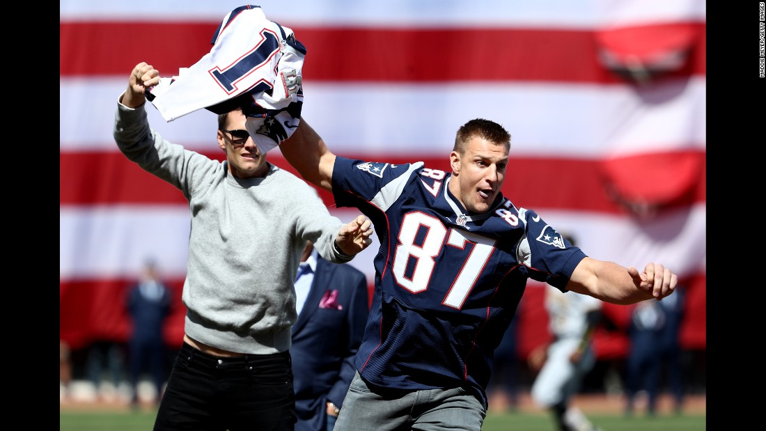 "New England Patriots tight end Rob Gronkowski runs off with the Super Bowl jersey of teammate Tom Brady during the Opening Day ceremonies of the Boston Red Sox on Monday, April 3. The playful bit came after Brady's jersey had been stolen for real <a href=""http://www.cnn.com/2017/03/20/sport/tom-brady-stolen-super-bowl-jerseys-recovered/"" target=""_blank"">and recovered in Mexico.</a>"