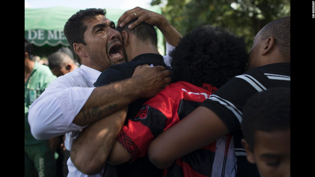 People cry Saturday, March 1, during the burial of Maria Eduarda Alves da Conceicao, a 13-year-old who was killed by a stray bullet during a shootout between police and alleged drug traffickers in Rio de Janeiro.