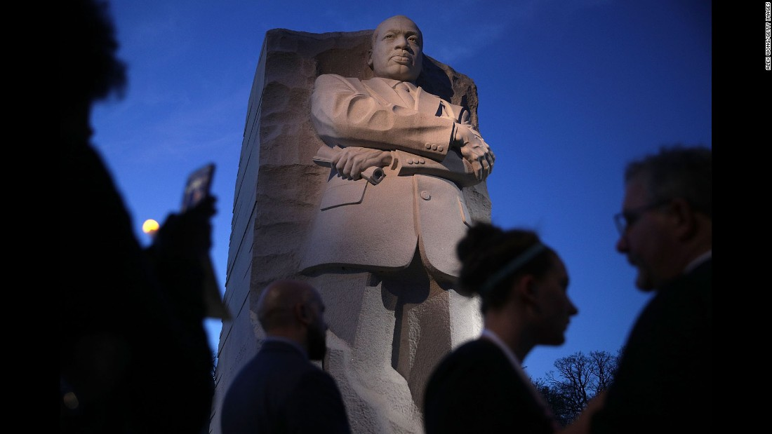 People participate in a candlelight vigil at the Martin Luther King Jr. Memorial in Washington on Tuesday, April 4. The civil-rights leader was assassinated 49 years ago.