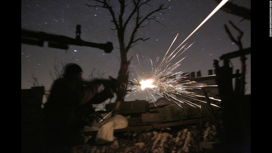 Ukrainian soldiers shoot machine guns as they fight pro-Russian separatists in Avdiivka, Ukraine, on Friday, March 31.