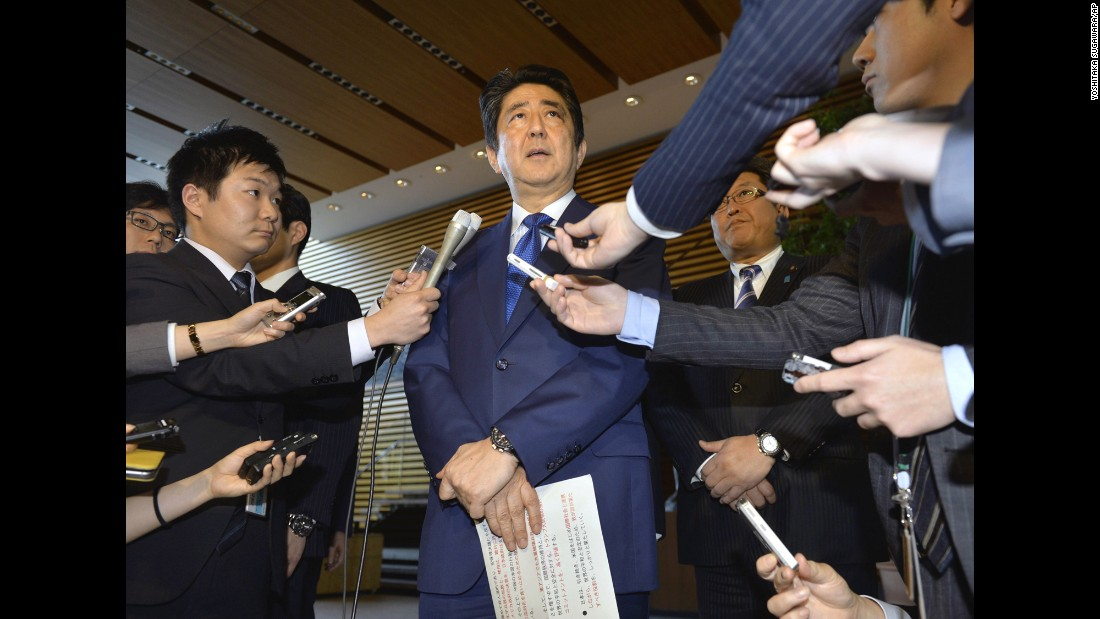 "Japanese Prime Minister Shinzo Abe speaks to reporters in Tokyo. ""The Japanese government supports the US government's resolve that it will never tolerate the spread and use of chemical weapons,"" he said."