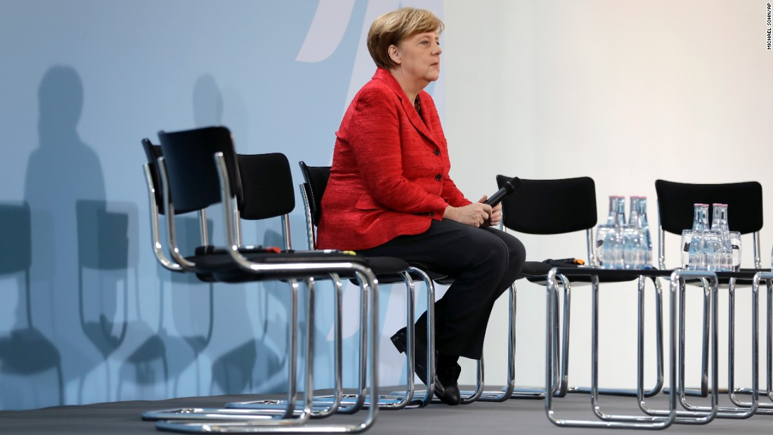 "German Chancellor Angela Merkel attends a refugee relief panel at an event honoring volunteers in Berlin. In a statement Friday Merkel said, ""This attack by the United States of America is understandable, given the aspect of the war crimes, given the suffering of innocent people and given the logjam in the UN Security Council."""