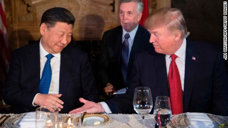 US President Donald Trump (R) and Chinese President Xi Jinping (L) prepare to shake hands during dinner at the Mar-a-Lago estate in West Palm Beach, Florida, on April 6, 2017. / AFP PHOTO / JIM WATSON        (Photo credit should read JIM WATSON/AFP/Getty Images)