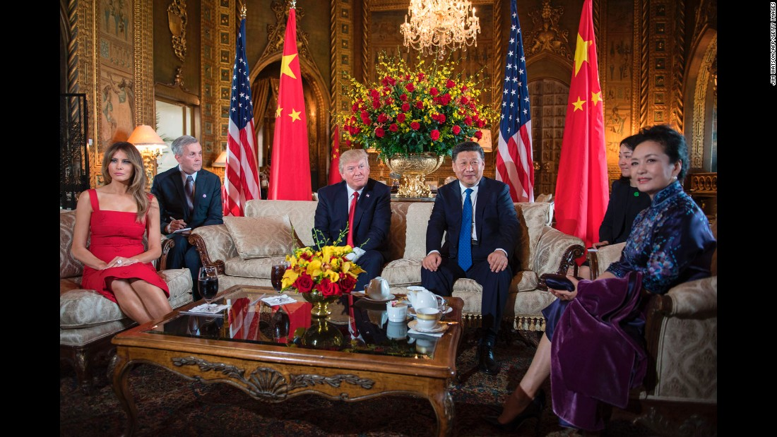 President Trump and Chinese President Xi Jinping sit together at Trump's Mar-a-Lago estate in Florida on Thursday, April 6. Joining them were first ladies Melania Trump, left, and Peng Liyuan, right.