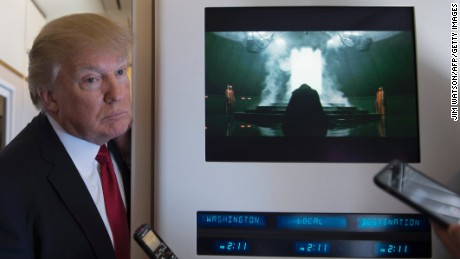 US President Donald Trump speaks to the press on Air Force One on April 6, 2017.